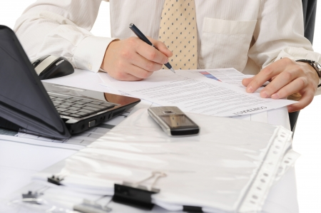 enterprises: Close-up of business person hands working with document