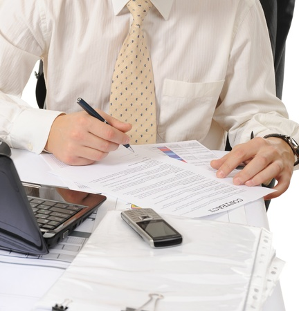 Close-up of business person hands working with document photo