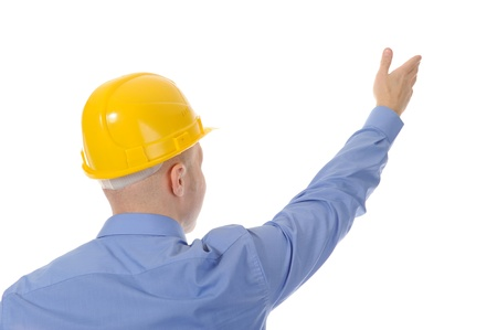 Businessman in helmet points finger up. Isolated on white background photo