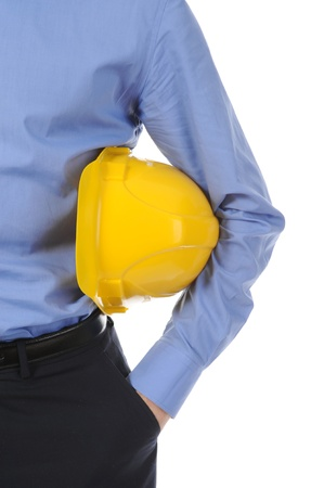 Businessman with construction yellow helmet. Isolated on white background photo