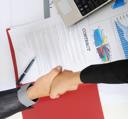 picture of handshake two business partners, when signing contract. photo