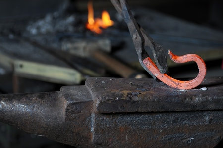 Making a decorative element in the smithy on the anvil Stock Photo - 8355656