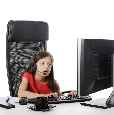girl with headphone looks in the monitor. Isolated on white background photo