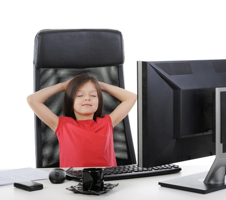 girl in the office in front of computer. Isolated on white background Stock Photo - 8404272