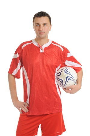 Football player in a red sports uniform. Isolated on white background photo