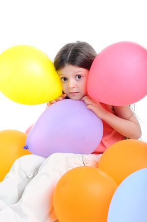 Surprised little girl with balloons. Isolated on white background photo