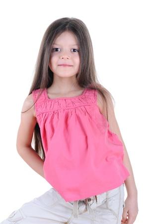Happy little girl posing. Isolated on white background photo