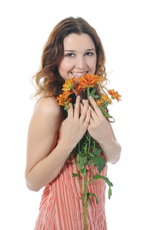 Beautiful brunette woman with a bouquet of flowers in their hands. Isolated on white background photo