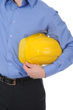 Businessman with construction yellow helmet. Isolated on white background Stock Photo - 8404353