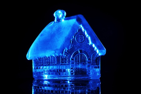 Glass toy house on a black background Stock Photo - 8442478