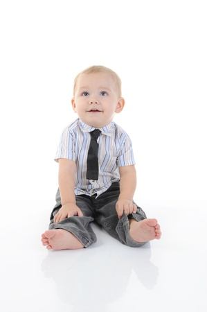 baby in suit: Portrait of a happy blue-eyed boy. Isolated on white background Stock Photo