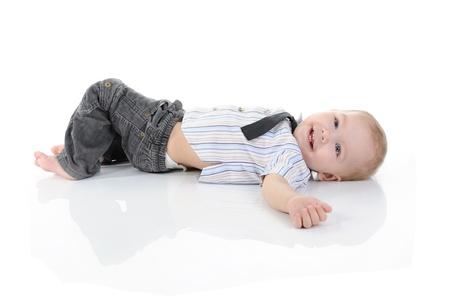 Portrait of a happy blue-eyed boy. Isolated on white background photo