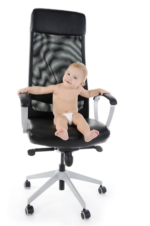 Portrait of a happy blue-eyed child in the chair. Isolated on white background photo