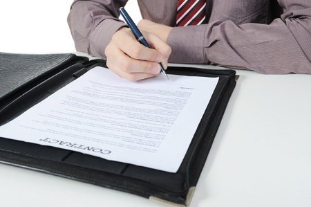 Businessman signs a contract. Isolated on white background Stock Photo - 8442483