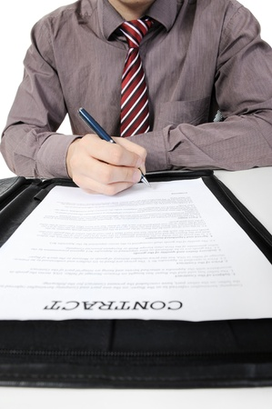 irrecognizable: Businessman signs a contract. Isolated on white background
