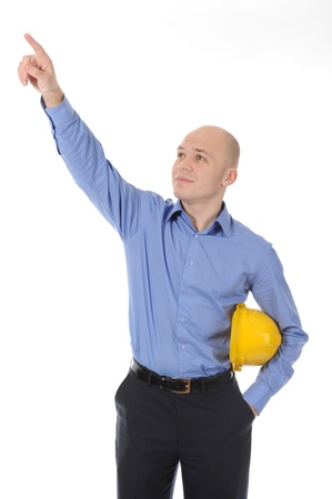 Businessman in helmet points hand up. Isolated on white background Stock Photo - 8442146