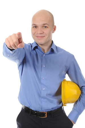 Businessman in helmet points hand up. Isolated on white background photo
