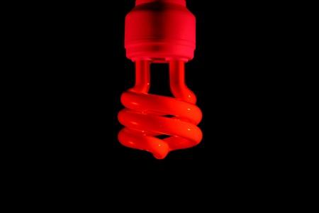 Energy saving bulb. Isolated on black background photo