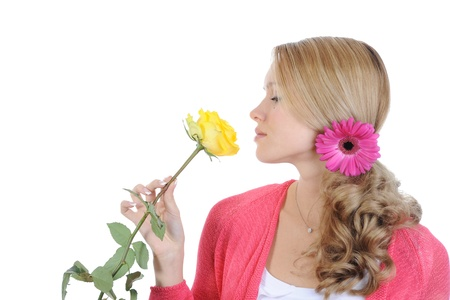 beautiful girl with a yellow rose. Isolated on white background photo