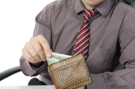 Businessman gets money from her purse. Isolated on white background Stock Photo - 8442515