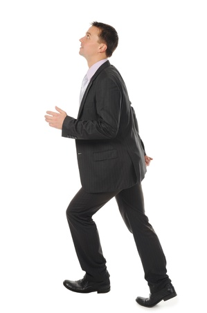 Businessman runs up the career ladder. Isolated on white background photo