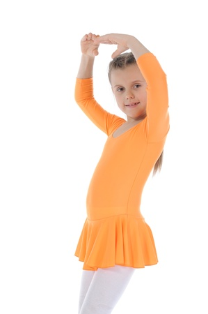 beautiful ballerina dancing in an orange dress. Isolated on white background photo