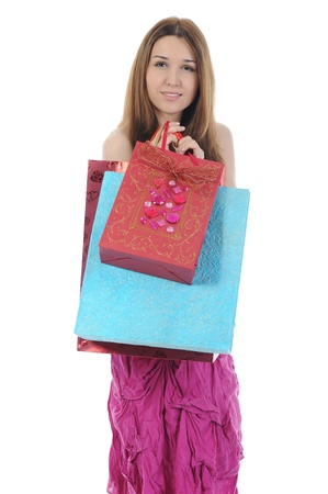 brunette with a shopping bag. Isolated on white background photo