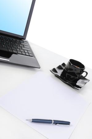 Laptop on the desk businessman. Isolated on white background photo