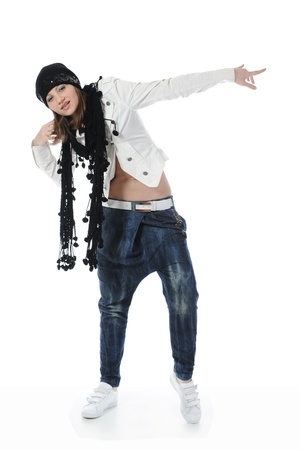 Young woman dancing hip-hop. Isolated on white background photo