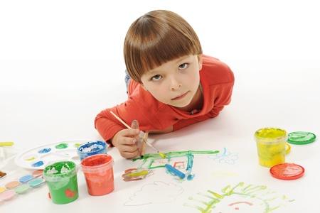little smiling boy draws paint. Isolated on white background Stock Photo - 8496100