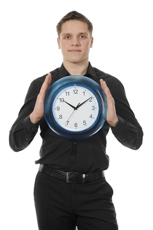 man in a black shirt holds clock photo