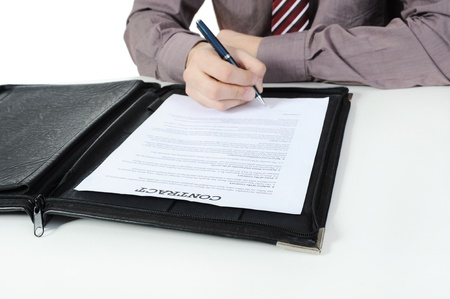 Businessman signs contract. Isolated on white background Stock Photo - 8500075