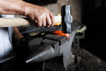 Making a decorative element in the smithy on the anvil Stock Photo - 8596823