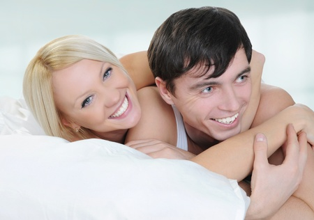 Happy family lying in bed in the morning Stock Photo - 8596832