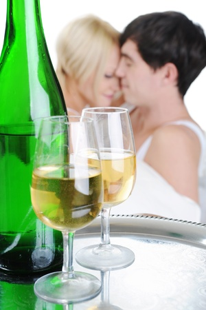 Young couple drinking champagne in bed. Isolated on white background Stock Photo - 8596812
