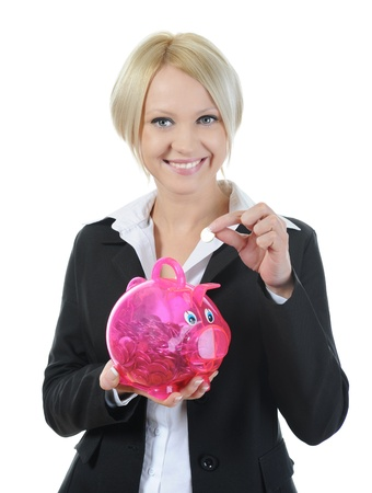 beautiful young woman putting coin into piggy bank. Isolated on white background Stock Photo - 8596794
