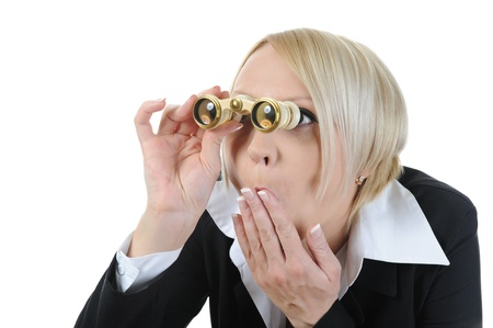 Businesswoman looking through binoculars. Isolated on white background photo