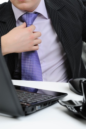 picture of a businessman adjusting his tie. photo