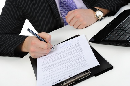 Businessman signs a contract. Isolated on white background photo