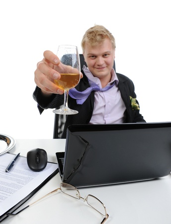 Drunk businessman drinking champagne on the job in the office. Isolated on white background Stock Photo - 8596795