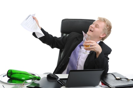 Drunk businessman drinking champagne on the job in the office. Isolated on white background Stock Photo - 8596805