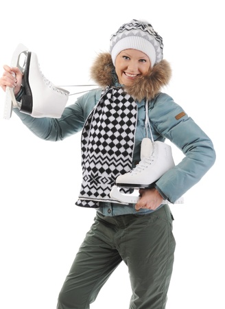 Smiling woman in winter style with skates. Isolated on white background photo