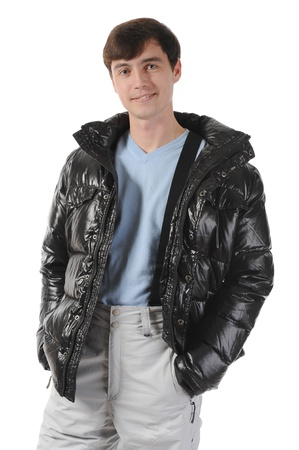 Portrait of young man in a winter jacket. Isolated on white background photo