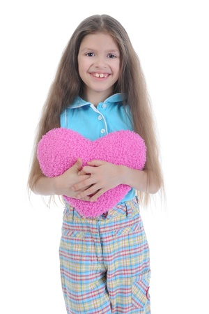 Little girl holding heart. Isolated on white background photo