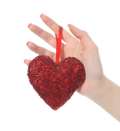 heart in hand young women.  Isolated on white background photo
