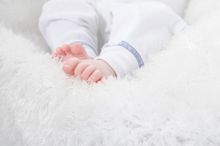 Image of small childrens feet in a bright room photo
