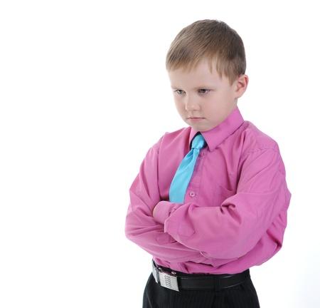 réfléchis petit garçon. Isolé sur fond blanc Banque d'images