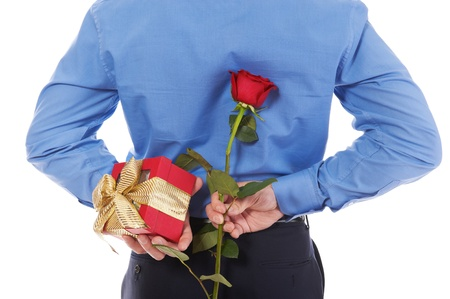 man with a gift box and a rose Stock Photo - 8734644