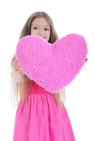 Little girl holding heart photo