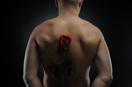 man  holding a red rose photo